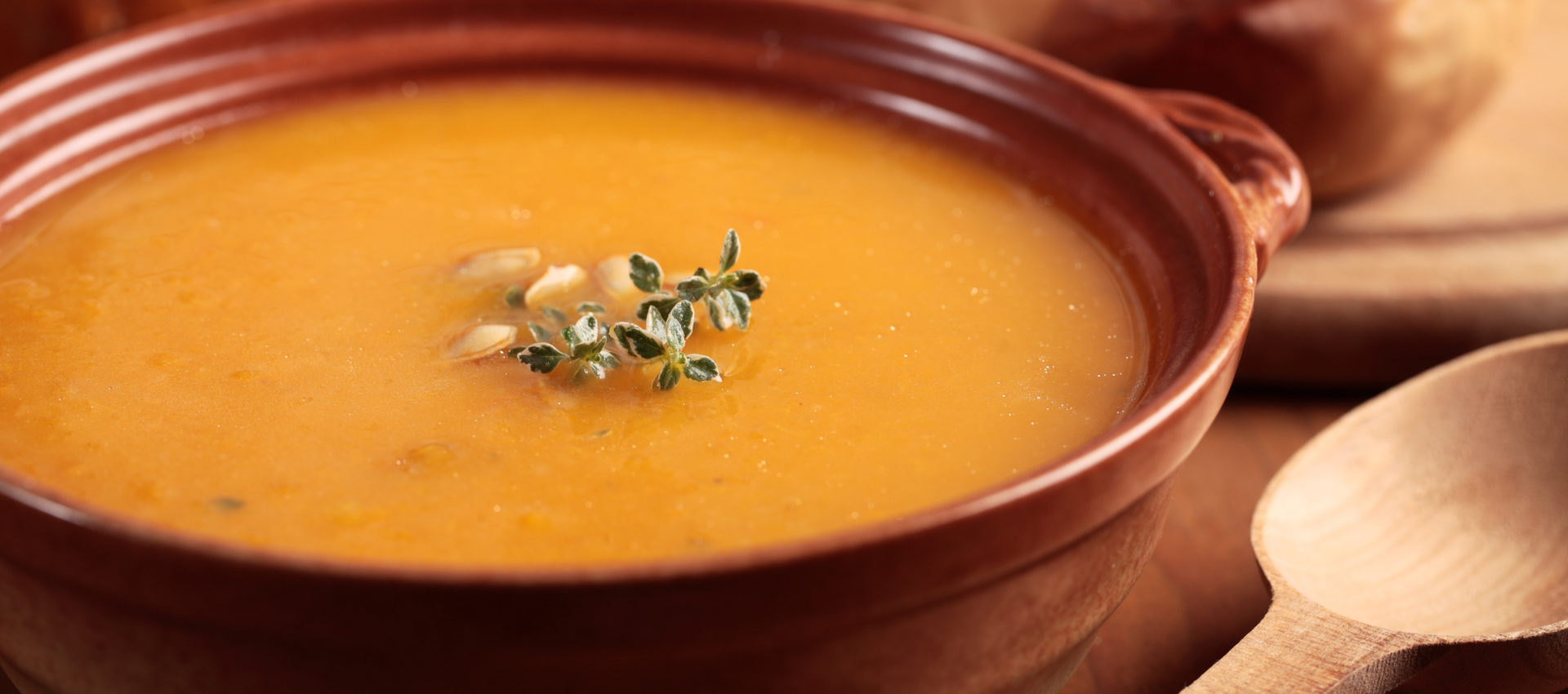 Bowl with pumpkin soup and and baked butternut squash