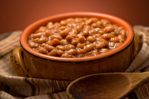 A bowl of delicious baked beans with molasses.